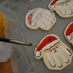 making hand print santa ornaments
